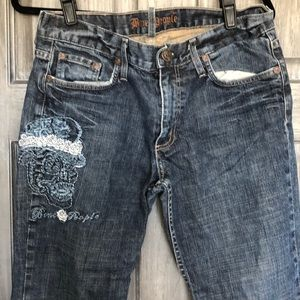 Distressed denim jeans with skulls size 32